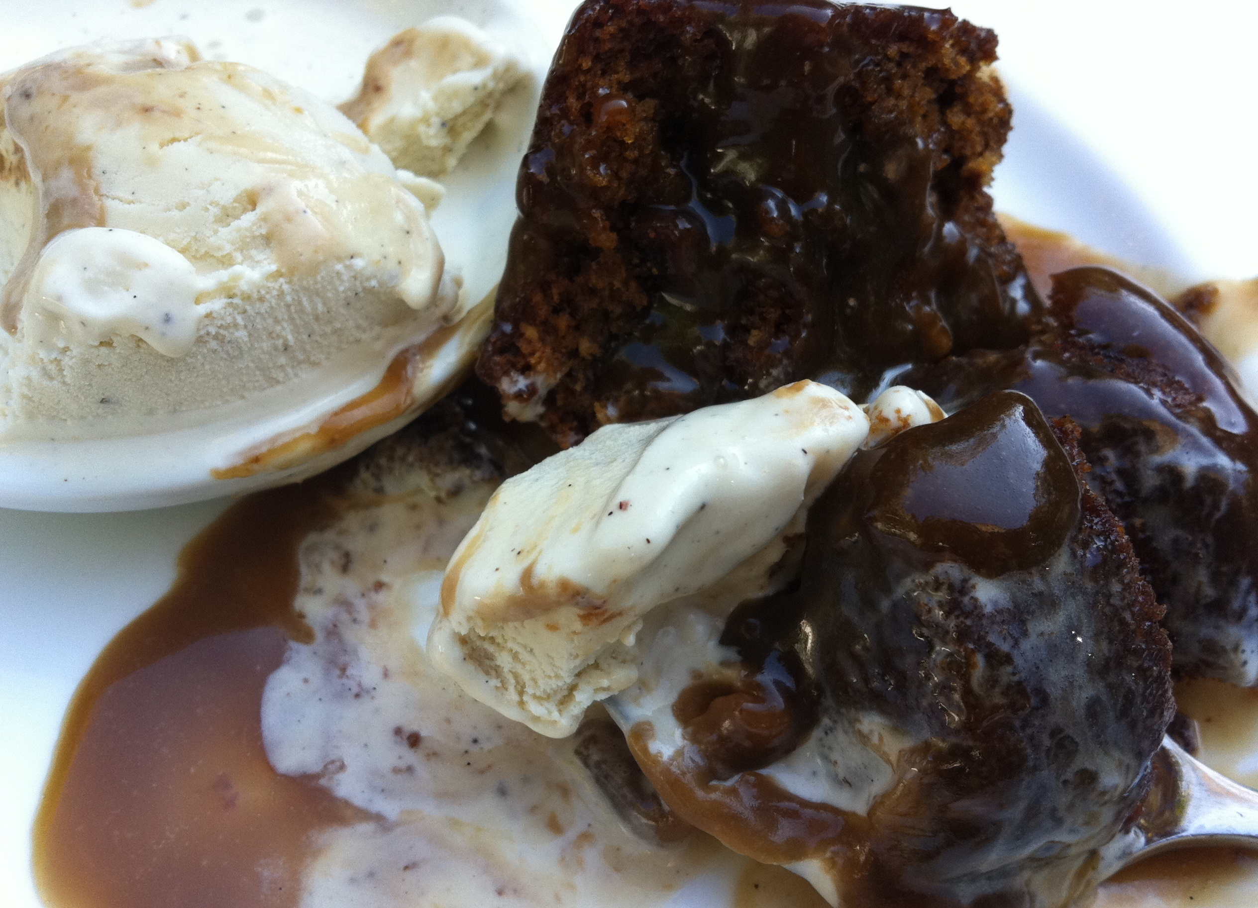 Individual sticky toffee puddings with vanilla bean ice cream ...