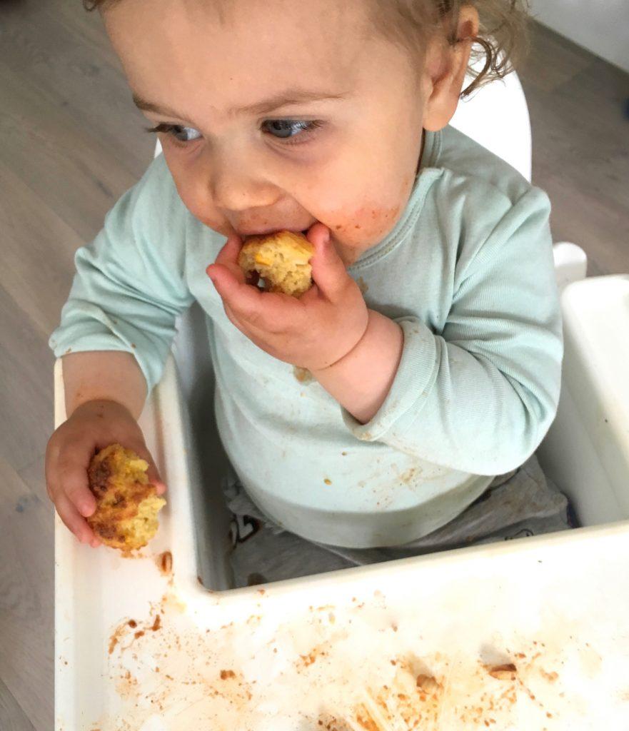Nino eating Cheesy Cornbread Muffins - 1